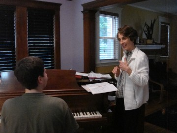 Nina teaching piano one on one